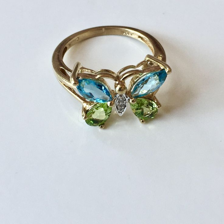 A personal favorite from my Etsy shop https://www.etsy.com/listing/536934013/10k-butterfly-ring
