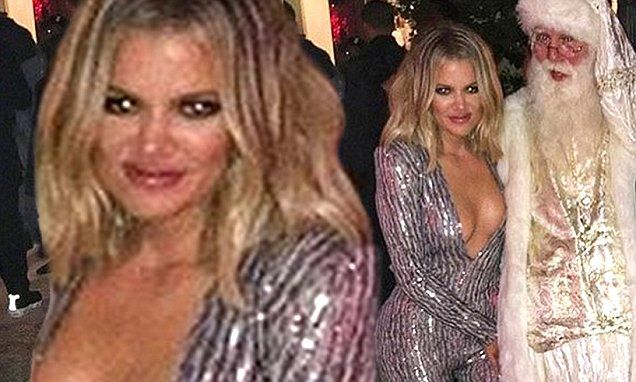 Khloe Kardashian shows off her chest in daring silver jumpsuit