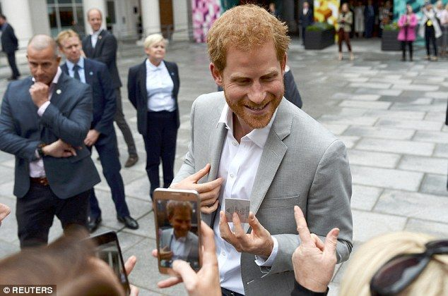 Hundreds of fans gathered in Belfast's St Anne's Square in a bid to catch a glimpse of Harry on Thursday, with some demanding photos and selfies with the redheaded royal