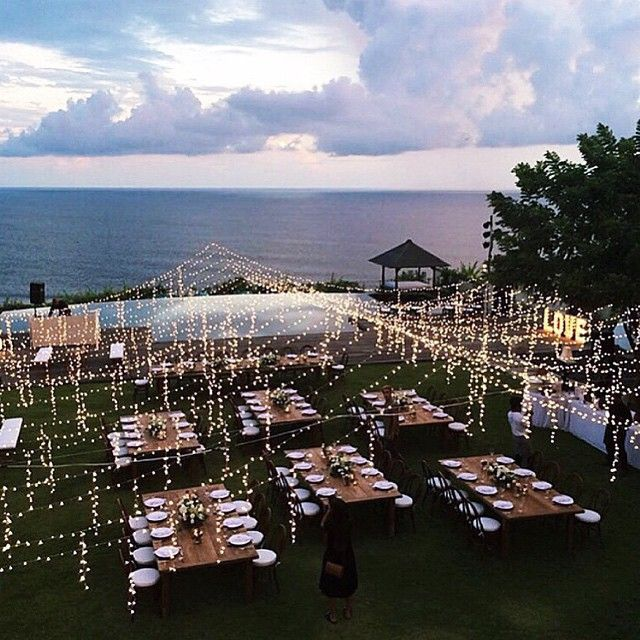 Outdoor lighting used to create the look of a tent structure http://thelane.com/style-guide/real-weddings/tropical-backyard-revelry