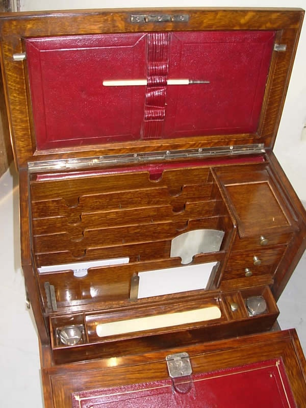 Good quality 19th century oak desk top stationery writing box. Lined cover with fall front and folding leather slope. Two ink wells, leather bound blotter, bone pen, two bone letter openers.