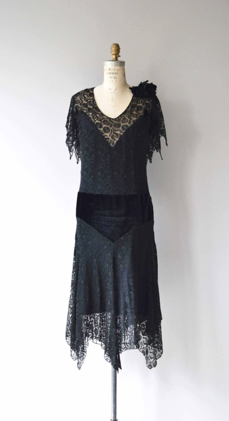 Antique 1920s dress black lace dress with lace capelet back, velvet flower at one shoulder, drop waist with velvet yoke and illusion lace neckline. --- M E A S U R E M E N T S --- fits like: small/medium bust: 34-37 waist: up to 32 hip: up to 40 length: 51 brand/maker: n/a condition: