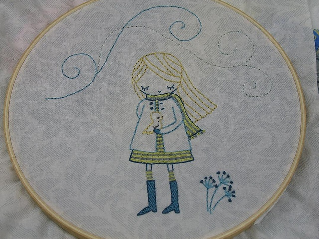 I felt like this little girl needed some fill to make her just a little more special; so, I filled her boots with backstitch and her dress and scarf with chainstitch. Background fabric is a Jinny Beyer fabric that a friend gave me.    Thought I would a  autumn clothing