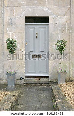 Grey Front Door of an Attractive Georgian Era London Town House by 1000 Words, via ShutterStock