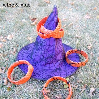 Homemade Halloween Games | wine & glue-witch hat ring toss