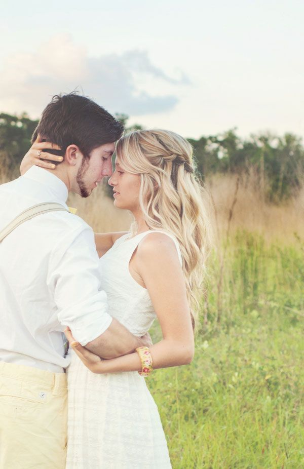 The passion in this shot is hard to deny! Photograph by Captured by Belinda http://www.storyboardwedding.com/my-favorite-shoot-to-date-throw-back-lazy-summer-days-lemonade-stand-crush-worthy-engagement-photos/