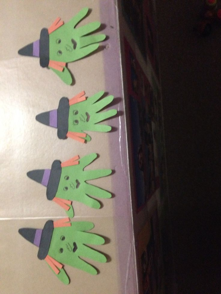 I had seen these handprint witches on Pinterest, but knew I could never get a handprint out of 4 infants (11 months down to 2 months)! So I went with tracing their hands instead to make these adorable little witches for Halloween. I absolutely adore these. They are now on a bulletin board with a witches pot and broom and of course their cute little footprint candy corns. We're brewing up sweet treats in the infant room! Love it!