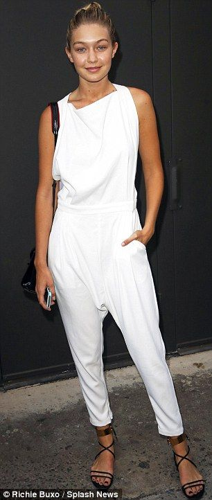The white stuff: Gigi Hadid left the Marc Jacobs show in a white jumpsuit http://dailym.ai/1uLm9zK #NYFW