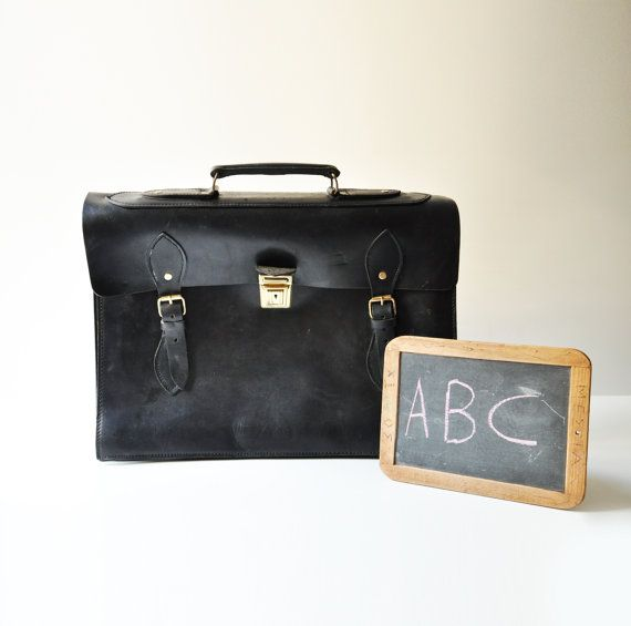 An awesome black leather briefcase from the 50s with beautiful aged patina and gorgeous details.  Overall the leather is very well preserved. It