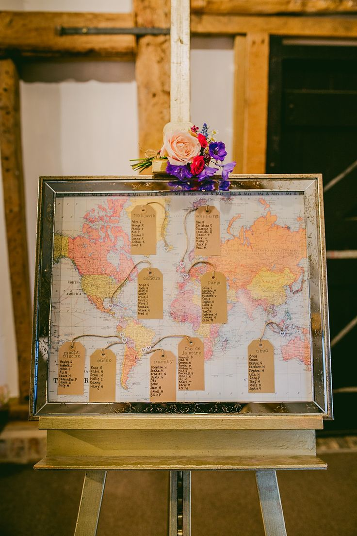 World map table plan inspiration | Photography by http://mariewoottonphotography.co.uk/