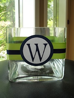 I have a few of these vases that I think I bought at IKEA. I love what a difference the ribbon and monogram make!
