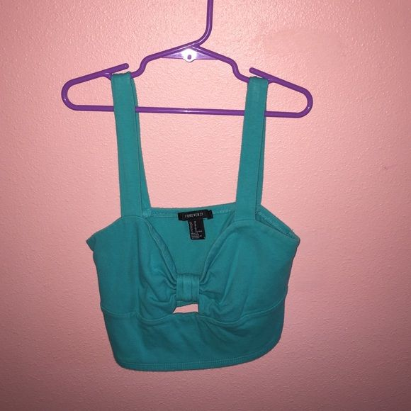 Forever 21 Bow Crop Top A blue, forever 21 bow designed crop top. It's a size medium but can stretch over your boobs! Forever 21 Tops Crop Tops