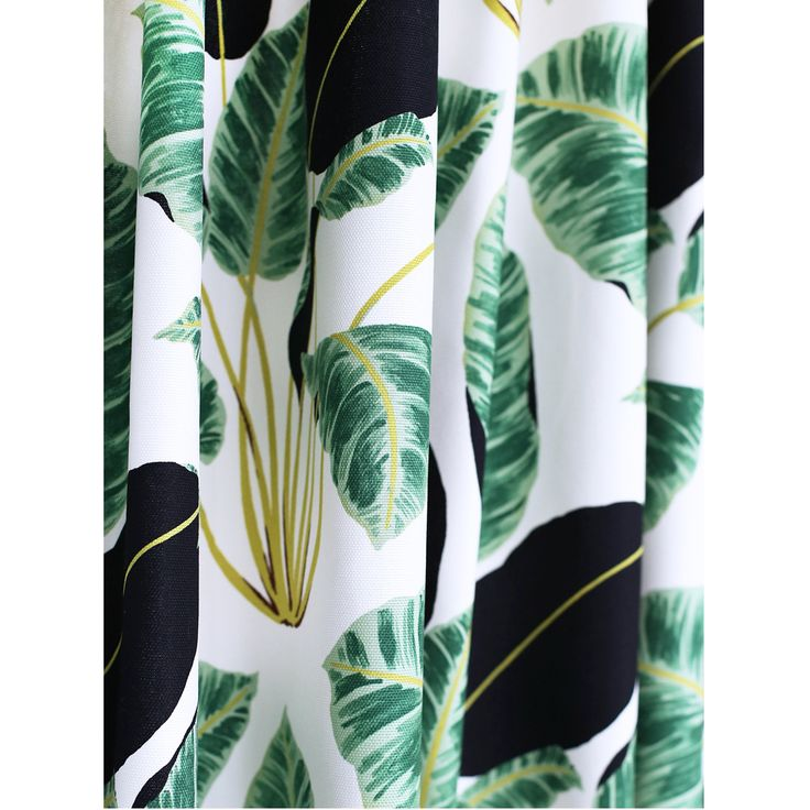 As seen in Style at Home magazine! A graphic banana leaf fabric in shades of green, black, citrine and white.  Makes perfect drapery fabric and is suitable for