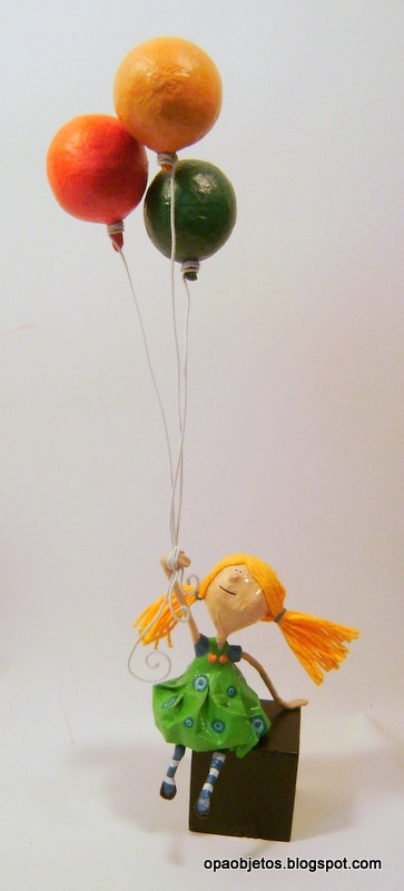 Girl with balloons. Paper mache