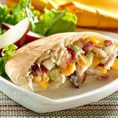 Apple 'N Cheddar Tuna Pitas  Ingredients      2 cans (5 oz. ea.) tuna in water, drained and flaked     1/3 cup Hellmann's® or Best Foods® Mayonnaise Dressing with Olive Oil     1/4 cup finely chopped celery     1/4 cup finely chopped apple     1/4 cup dried cranberries     1/4 cup coarsely chopped walnuts (optional)     4 slices cheddar cheese [or American cheese], cut up     2 Tbsp. finely chopped red onion     2 (8-in.) pita breads [or whole wheat pita breads], halved…