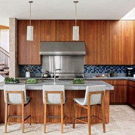 This Hamptons home kitchen by design firm Sawyer | Berson and decorator Randi Puccio has a Wolf range and hood and Holly Hunt stools.    Related: See More Home Remodeling & Renovation ideas