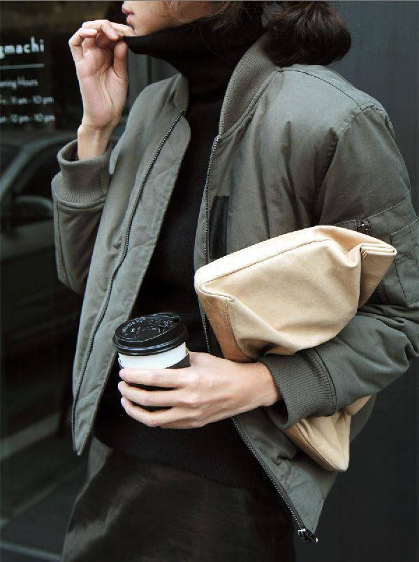 Turtleneck, green bomber jacket and coffee.