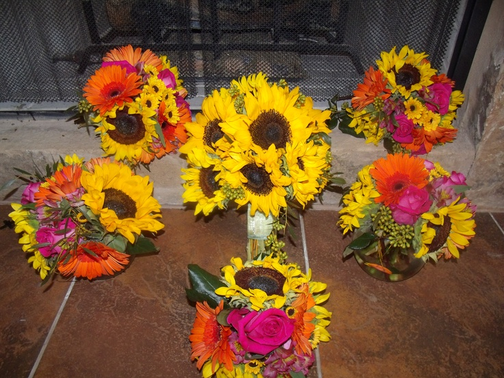 These bridesmaids bouquets surround the Bridal bouquet of chrysanthemums, roses, sunflowers, and gerber daisies in tones of yellow, pink, and orange by Austin Wedding Florist Bella by Sara http://bellabysara.com/new/