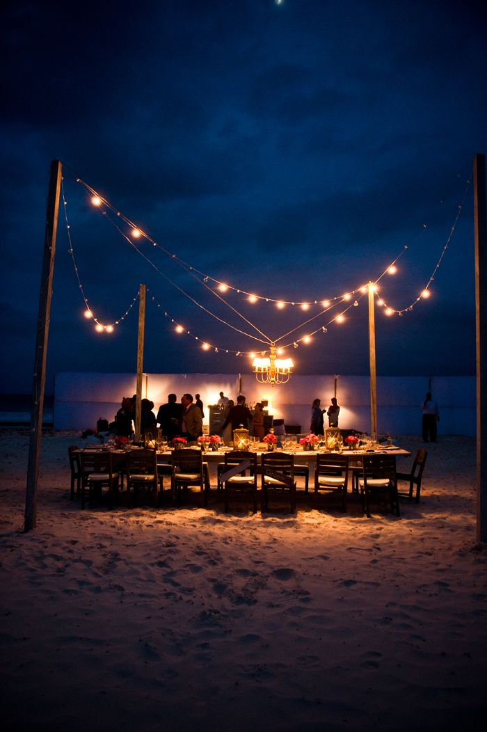 ideas for beach wedding party favors%0A Night time lights at the beach Dinner Party wedding