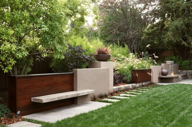 retaining wall with bench!  very modern but nice different take on your basic retaining wall
