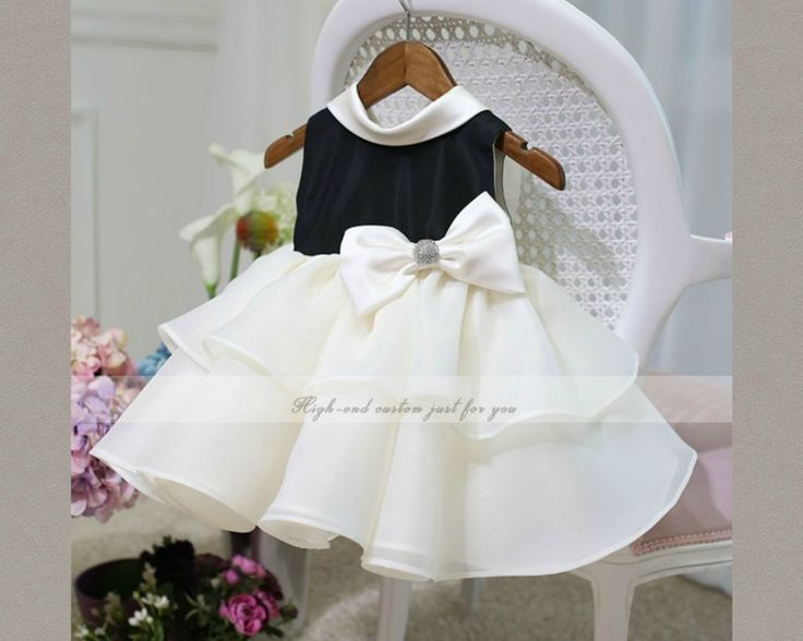 Big Bow Flower Girl dress. Available from 0 - 15 years. Color: Black and Off white. Material: Satin, purified cotton lining, soft polyester fabric. Free shipping.