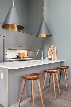 Grey pendant lighting with gold interior accents add an extra dimension to this tiny galley kitchen, and despite the lofty ceilings, make it feel considerably more cosy. http://www.urbanroad.com.au/