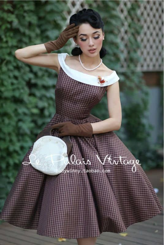 8054b0c45824 Raspberrily smiling pale-skinned copperhead in mauve polkadot A-line dress  Image source