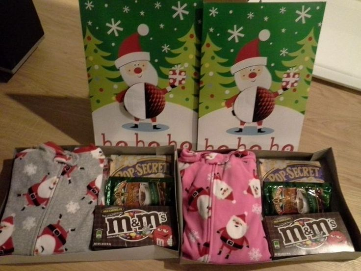 Christmas Eve Boxes! On Christmas Eve, the doorbell will ring and the kids will find these boxes with cozy PJs and snacks for watching a holiday movie. They are a gift from their Elf on the Shelf.
