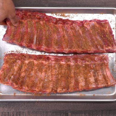 No barbecue pit? No problem. You can make fall-off-the-bone tender ribs in the oven with our melt-in-your-mouth homemade dry rub and easy bbq sauce recipe.