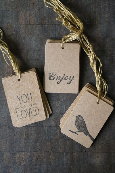 """Kraft gift tags, pre-strung with gold twine. The mini tags have straight corners and the rest have slightly rounded corners. Mini - 0.75"""" x 1.25"""" Small - 1.25"""" x 2"""" Medium - 1.5"""" x 2.5"""" Large - 2"""" x 3"""
