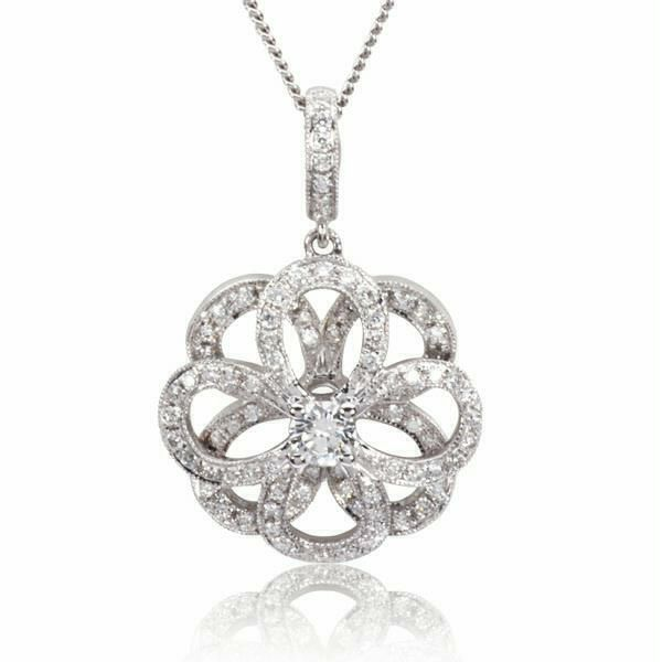 Product Code: 10070194 This jewellery masterpiece has been perfectly hand crafted in cool 18ct white gold. The twinkling chain falls elegantly to a swirling floral design which has been luxuriously blanketed in pure white diamonds with a large round brilliant diamond set within the centre for a flawless finish. Total Diamond Carat Weight 0.76ct.