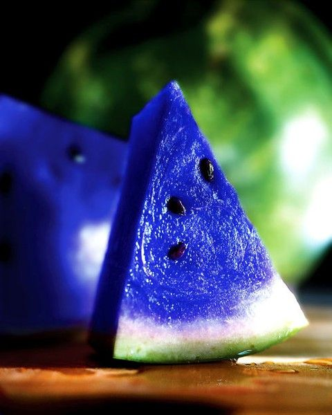 """[HOAX] Moonmelon // According to its caption on Pinterest, """"This fruit grows in some parts of Japan, and is known for its vibrant blue color.""""  But, the photo is altered and the fruit made up."""
