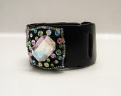 Black genuine leather cuff with colorful fashion brooch and adjustable snaps. $27 free shipping