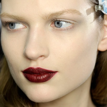 Deep red lipstick in varying berry hues; one of autumn's trickier trends but once mastered, you'll revel in its complexion perfecting powers. Lifting tired skin, allowing for minimal make-up and adding a luxuriant element to winter's faux furs and brocades, from dark red lipstick to berry tones, red lip lacquer and a rouge noir lip crayon, our favourite dark red lipsticks prove that matte red lips and dark berry lipstickare wearable when you know how | #beauty #trends