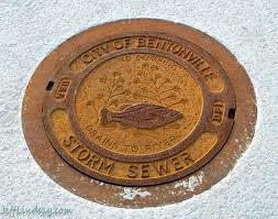 Bentonville, AR. Storm sewer manhole cover.