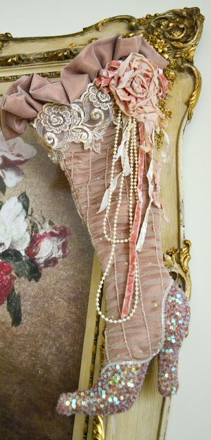 "Like how this ""stocking"" is adorned with lace, ruffles, pearls, ribbons, and fabric rose!"