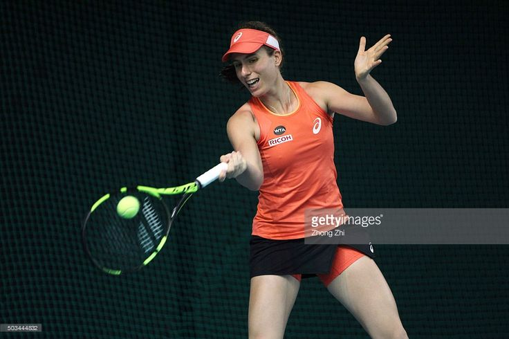 Johanna Konta of Great Britain returns a shot during the match against Qiang Wang of China during Day 3 of 2016 WTA Shenzhen Open at Longgang Sports Center on January 5, 2016 in Shenzhen, China.