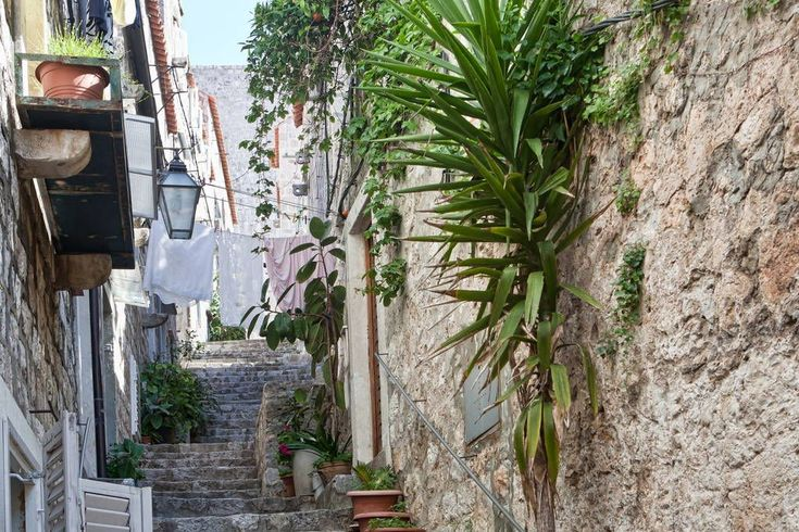 Apartment in Dubrovnik, Croatia. The apartment is cosy, completely refurbished, one bedroom, open plan kitchen and lounge area, with small bar table and stools for dining or just having a glass of wine, sofa bed, TV, air conditioning in both lounge and bedroom.  The apartment is ...