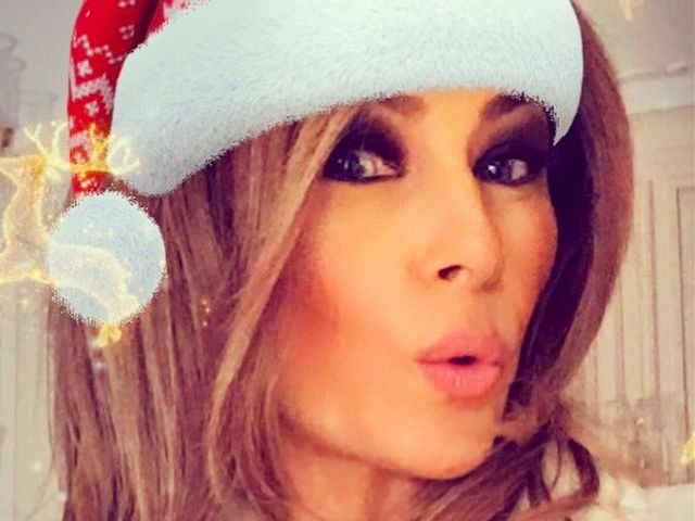 First lady Melania Trump tweeted a selfie on Christmas morning, depicting herself wearing a Santa hat and blowing a kiss to the camera.