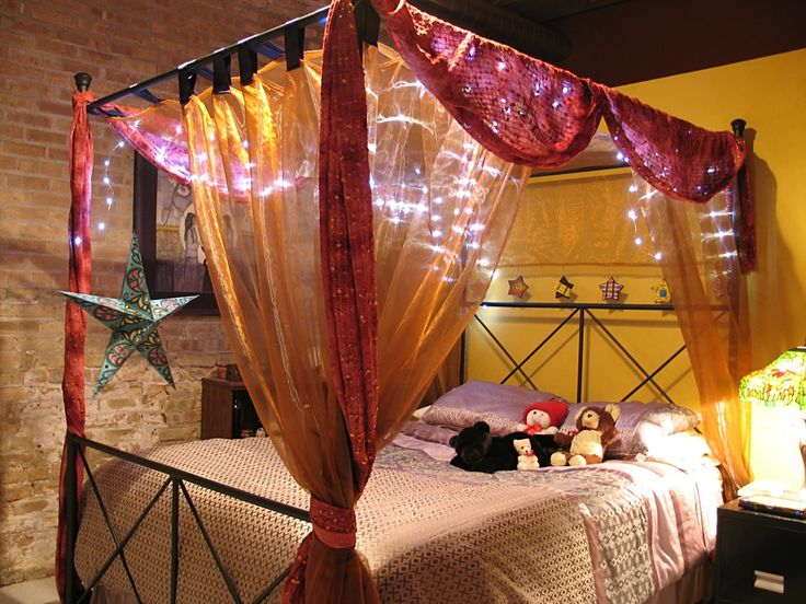 stylish bedroom decor using canopy bed canopy bed with canopy bed curtains and starry string lights also bedding with nightstand and stained glass lamp - Orange Canopy Decorating