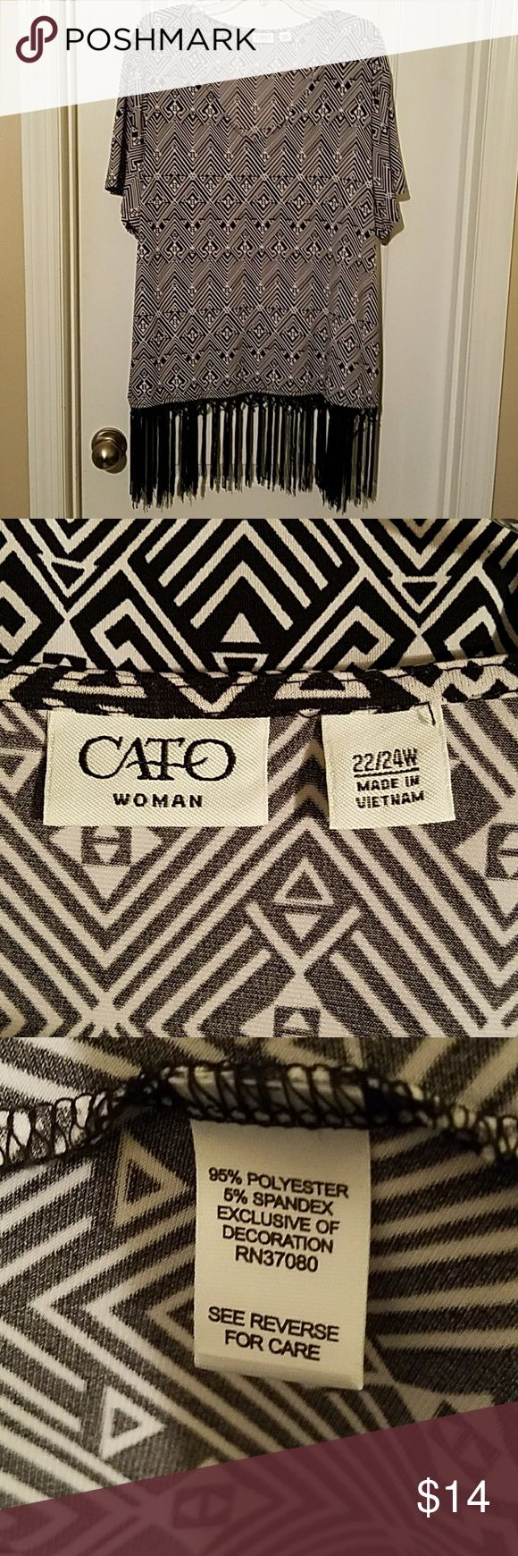 """❣Sale Today Only❣NWOT ❣Tribal Print Fringed Top Never worn! Black and white tribal print top with fringe. 95% Polyester 5% Spandex.   Size 22/24. Bust 26.5"""". Length (not including fringe) 26.5"""". Fringe 7"""" Cato Tops"""