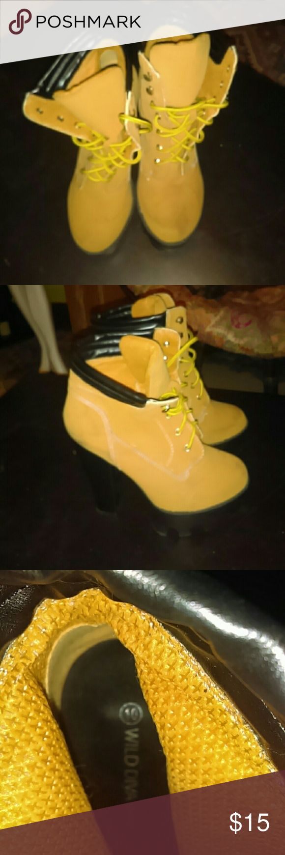 Wild Diva Women's boot stilettos Wild Diva Women's boot timberland style  stilettos size 10 awesome shoes just too small for me a I've only tried them on once but there is some brown marks and scufs but other than that good condition I'm sure the black mark scufs will be easy to get out wild diva  Shoes Lace Up Boots