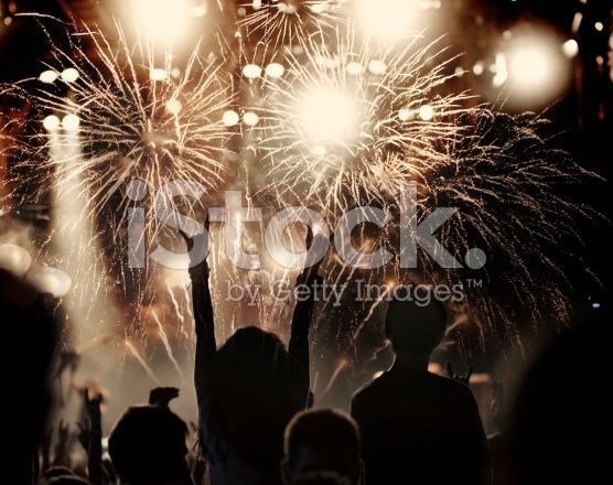 New Year concept - cheering crowd and fireworks royalty-free stock photo