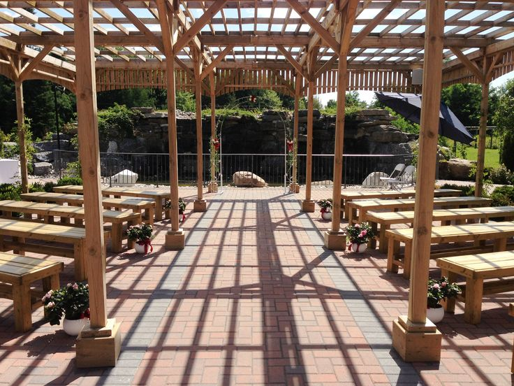 Outside ceremony under the terrace pergola in front of the for Terrace pergola