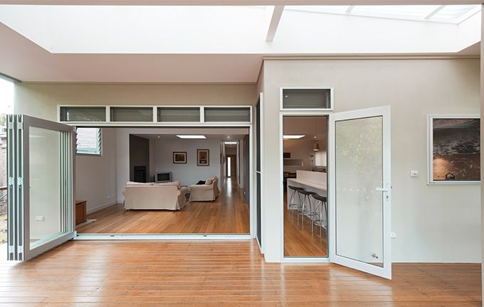 Seamless flooring opens out to exterior atChatswood House by Bijl Architecture