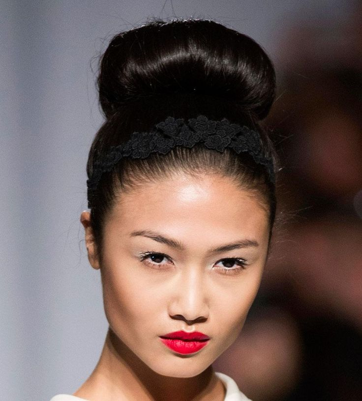 Runway-Inspired Prom Updos for Long Hair - chic sock bun with black lace headband