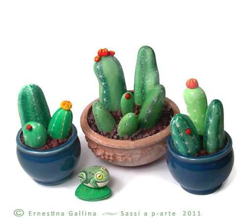 A collection of cacti painted on rocks