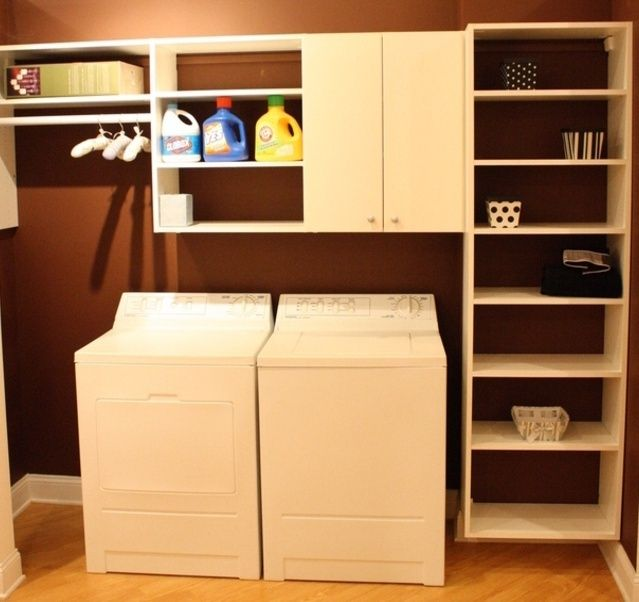 California Closets laundry room - hanging, open shelves, cupboards