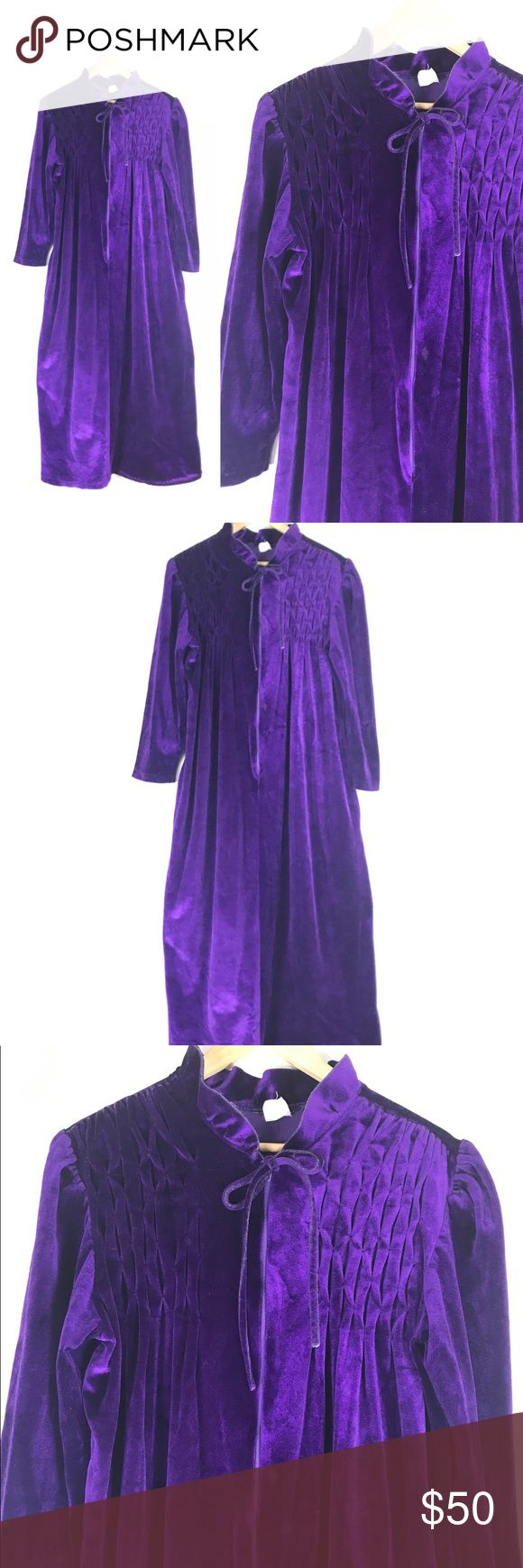 "1960s purple velvet duster robe 🦄 VTG maxi gown 1960s purple velvet maxi duster robe! lovely pleating on the chest with bow tie and partial front zipper. looks like this one was used as a smoking jacket because there are a few small burn holes, see photos. this material attracts a lot of fuzz so there is some thats a bit hard to get off. otherwise excellent condition! tag is too worn to make out.  MEASUREMENTS:  laying flat, double when appropriate 50.25"" long 24"" bust 18"" shoulder to…"