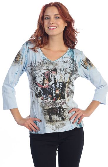 This cowgirl T-shirt in has a beautiful design with studded rhinestones and 3/4 sleeve. Great to wear with your jeans or our own Denim Gauchos. Perfect for a night out for dancing.. This T-shirt has been pre-washed andtherefore, it will not shrink. 100% cotton. Hand or machine wash cold. Made in USA